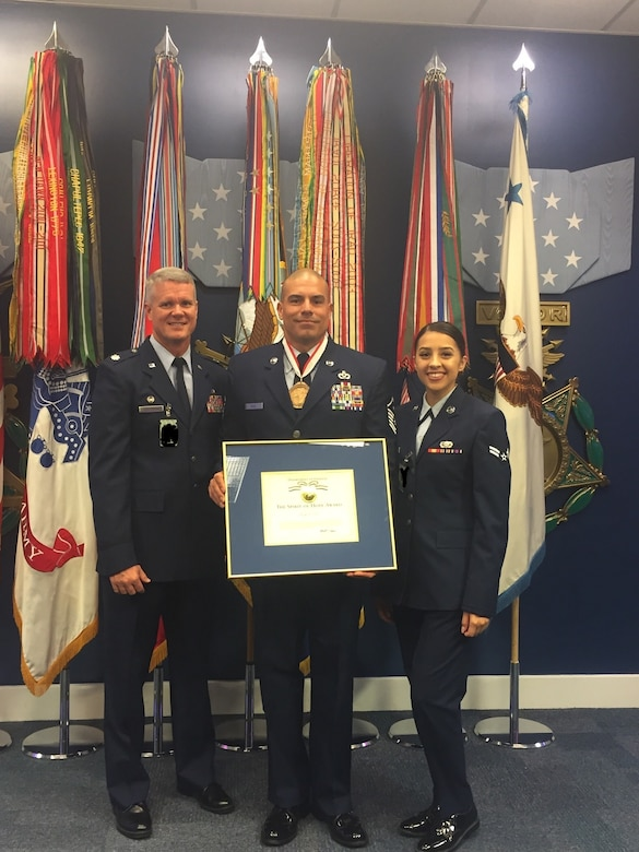"U.S. Air Force Master Sgt. Jorge L. Arce, 86th Aircraft Maintenance Squadron first sergeant, poses for a photo with his daughter, Airman 1st Class Sybella Crespo, 56th Logistics Readiness Squadron, and Lt. Col. Jeffrey Westerman, 86th AMXS commander, after the Bob Hope ""Spirit of Hope"" award ceremony at the Pentagon, Sept. 27, 2019. (Courtesy photo/Photo edited to black out security badges)"