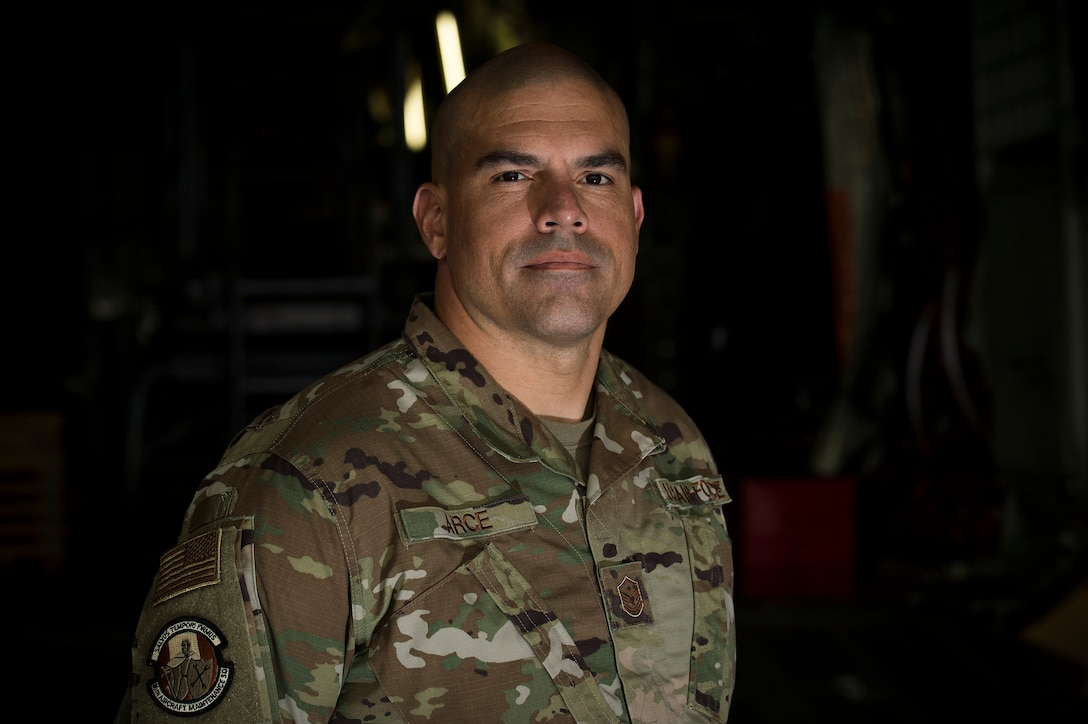 """U.S. Air Force Master Sgt. Jorge L. Arce, 86th Maintenance Squadron first sergeant, poses for a photo in the dual-bay hangar at Ramstein Air Base, Germany, Oct. 8, 2019. Arce won the 2019 Bob Hope """"Spirit of Hope"""" for the Air Force earlier this year and was presented his award at a ceremony held at the Pentagon, Virginia, Sept. 27, 2019. (U.S. Air Force photo by Staff Sgt. Jonathan Bass)"""