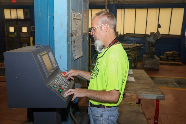 Sheet Metal Mechanic Ryan Ward operates the new LVD Strippit Machine in the Sheet Metal Shop (Shop 17).