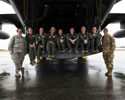 Staff Sgt. Stephanie Rowland, Lt. Col. Kenda Garrett, Master Sgt. Erin Evans, Staff Sgt. Jessica McGilton, Maj. Janelle Guillebeau, Senior Airman Ashlyn Hendrickson, Technical Sgt. Nicole Beck, Lt. Col. Sarah O'Banion, and Staff Sgt. Tracie Winston after landing in Abbottsford, British Columbia, Canada, to support the annual Sky's No Limit – Girls Fly Too aerial symposium. This is the first all-female C-130H crew in the history of the annual event.