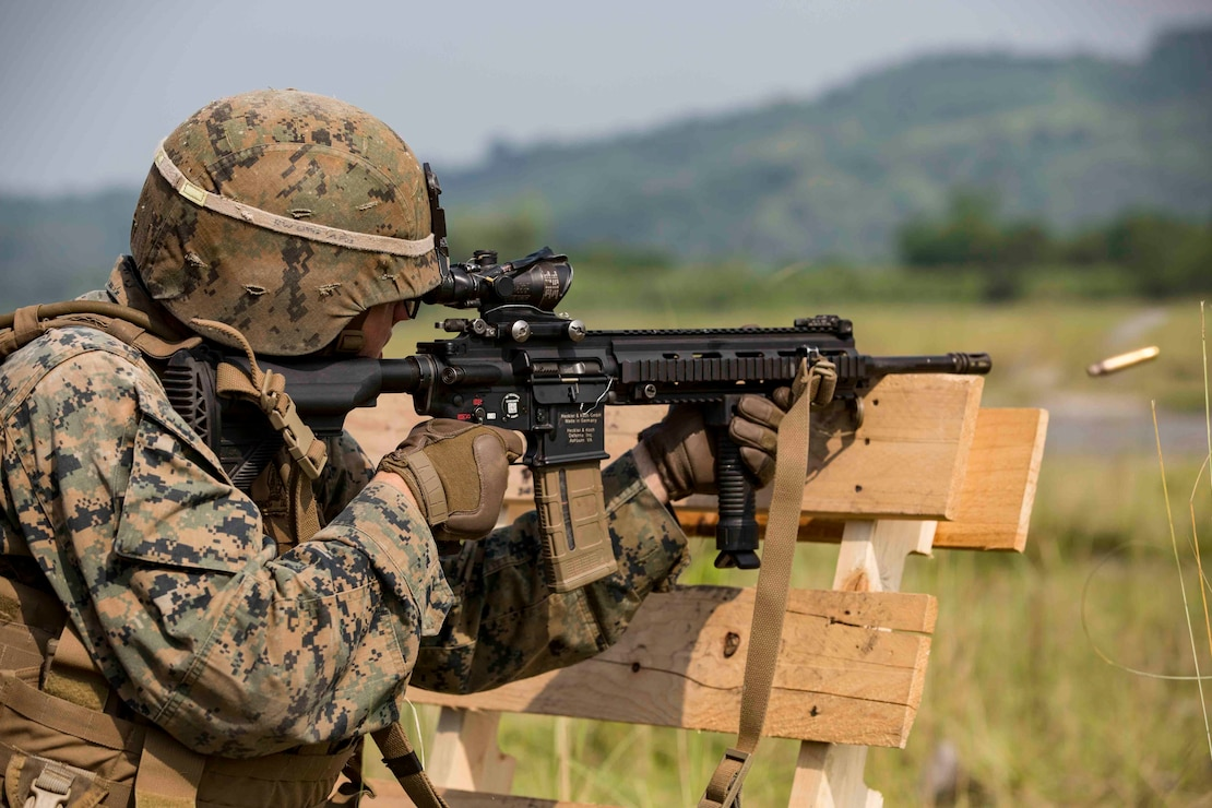 "U.S. Marine Lance Cpl. Ryan Watts fires an M27 Infantry Automatic Rifle while participating in a live-fire range during exercise KAMANDAG 3, on Colonel Ernesto P. Ravina Air Base, Philippines, Oct. 12, 2019. KAMANDAG helps participating forces maintain a high level of readiness and responsiveness, and enhances combined military-to-military relations, interoperability, and multinational coordination. KAMANDAG 3 is a Philippine-led, bilateral exercise. KAMANDAG is an acronym for the Filipino phrase ""Kaagapay Ng Mga Manirigma Ng Dagat,"" which translates to ""Cooperation of the Warriors of the Sea,"" highlighting the partnership between the U.S. and Philippine militaries. Watts, a rifleman with Easy Company, 2nd Battalion, 2nd Marine Regiment, is a native of Oxford, Miss. Marines with 2nd Battalion, 2nd Marine Regiment are currently on a unit deployment program under 4th Marine Regiment, 3rd Marine Division."