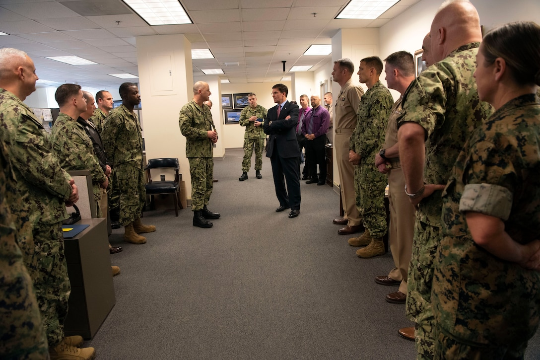 Defense Secretary Dr. Mark T. Esper speaks to service members in a room at the Pentagon.