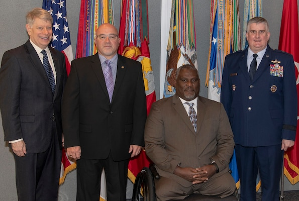 four leaders pose for a photo
