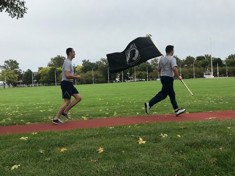 Members running with POW/MIA flag during 24 hour remembrance run