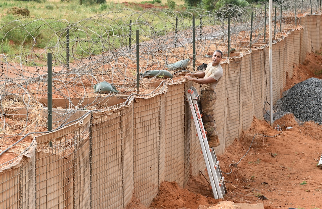 Tech. Sgt. secures a new cable for perimeter lighting