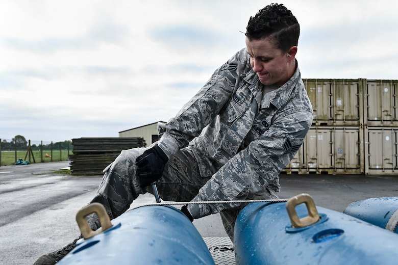 Senior Airman ensures the cap on a BDU-50 is secure