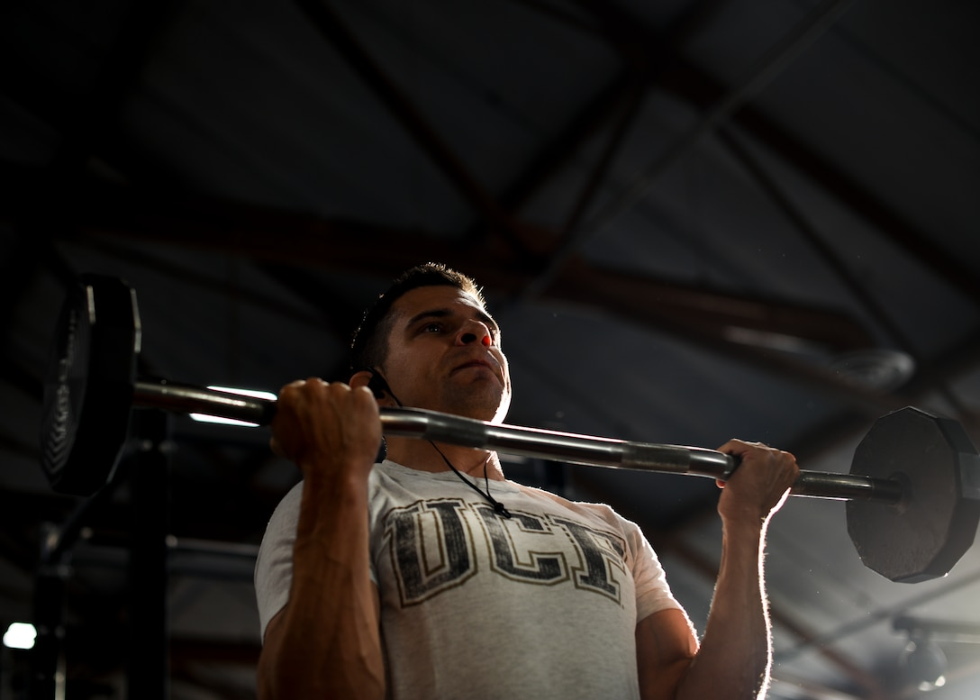 Major Richard Bottinelli, 90th Force Support Squadron operations officer, curls a barbell at the Independence Hall Fitness Center on F.E. Warren Air Force Base, Wyo., July 18, 2019. Along with a strict gym regiment, Bottinelli had to stick to a diet plan throughout his training.  (U.S. Air Force photo by Staff Sgt. Ashley N. Sokolov)