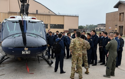 Cadets with the Latin American Cadet Initiative view a UH-1N Iroquois helicopter during a tour of the 1st Helicopter Squadron on Joint Base Andrews, Md., Oct. 16, 2019.