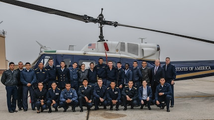 Members of the 1st Helicopter Squadron and cadets from the Latin American Cadet Initiative pose for a photo following a tour of the squadron on Joint Base Andrews, Md., Oct. 16, 2019.