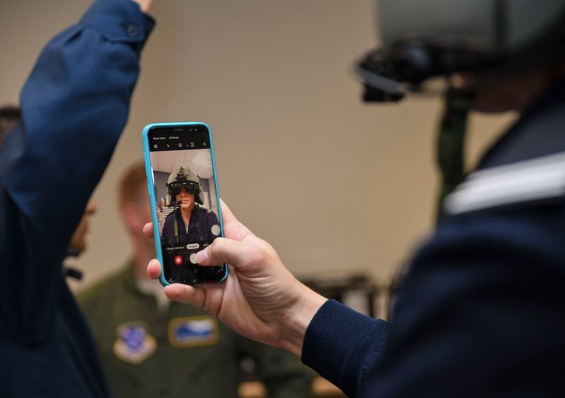 A cadet captures a photo of himself with a HGU-56/P helmet on during a 1st Helicopter Squadron tour with the Latin American Cadet Initiative on Joint Base Andrews, Md., Oct. 16, 2019.
