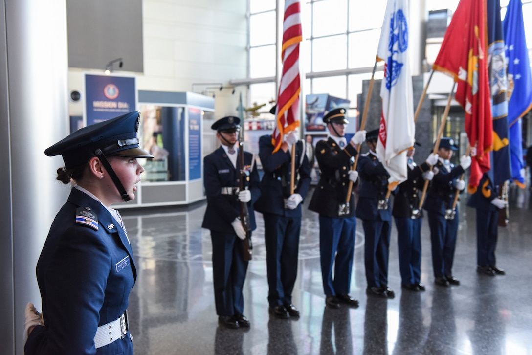 Cadet 2nd Lt. Michaela Melancon, of the Civil Air Patrol's National Capital Wing, sings the national anthem during a joint color guard performance at DIA Headquarters, Oct. 10.