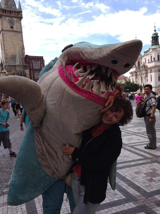 Traveler, Kaitlyn Brewer, stands with a shark in Copenhagen Denmark, 2014.
