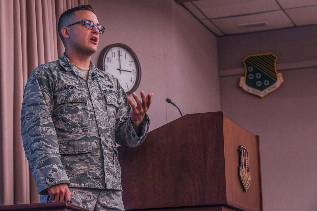"""Capt. Tyler M. Moore, 67th Cyberspace Wing acquisitions officer, Joint Base San Antonio, Texas, articulates his idea to the judge's panel during Air Combat Command's 2020 Spark Tank competition at the Creech Conference Center on Joint Base Langley-Eustis, Virginia, Oct. 16, 2019. Moore pitched an idea called """"Wholistic Care Management,"""" which he believes could sharpen the Air Force's approach toward suicide prevention to ensure readiness of the force. (U.S. Air Force photo by Tech. Sgt. Nick Wilson)"""