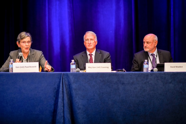 """U.S. Air Force Gen. (ret.) Ellen Pawlikowski, Maj. Gen. (ret.) Craig Cooning, and Mr. David Madden, reflect on their experience as former leaders at the Space and Missile Systems Center during a """"Legacy Panel"""" session at Space Industry Days, Los Angeles, Calif., Oct. 17, 2019. During the panel, they discussed the importance of speed and taking risks to build the future of space that the nation needs. Space Industry Days provide a forum for industry to work with U.S. Air Force space acquisition professionals to deliver space capabilities faster and smarter.  (U.S. Air Force photo by Van De Ha)"""