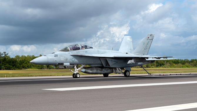 A U.S. Navy Strike Fighter Squadron 106 F/A-18F Super Hornet aircraft from Naval Air Station Oceana, Va., performs an arrested landing at MacDill Air Force Base, Fla., Oct 16, 2019. Arrested landings allow pilots to achieve rapid deceleration when landing aboard an aircraft carrier. They are performed by lowering the arresting hook until it engages an arresting cable, which is stretched across the landing area and absorbs the energy of the aircraft once engaged.