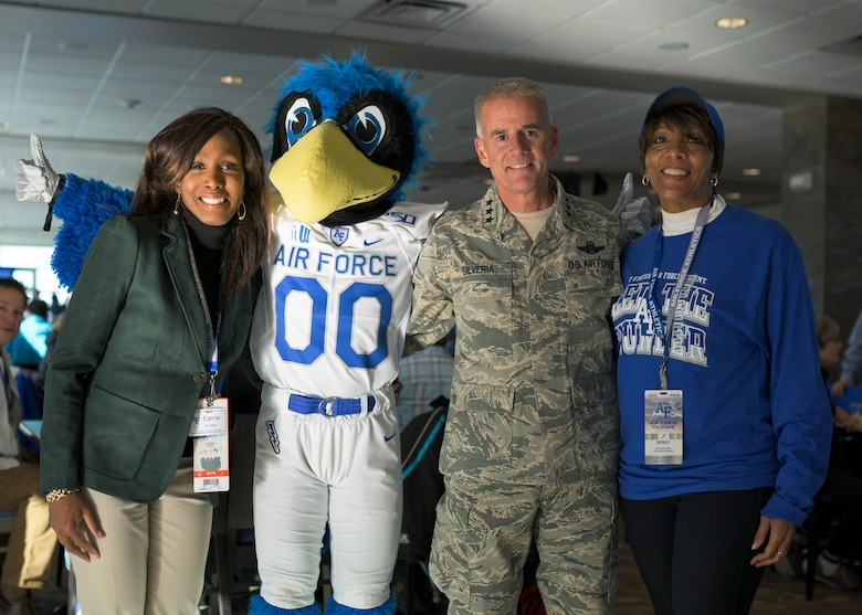 (From left) Dr. Carrie Baker, diversity and inclusion officer at Headquarters, Air Force Space Command stands with the U.S. Air Force Academy mascot, Lt. Gen. Jay Silveria, USAFA superintendent, and Ms. Yvonne Roland, chief diversity and inclusion officer at USAFA, Oct. 12, 2019, at Falcon Stadium, USAFA. Dr. Baker was formally recognized at the USAFA football game for her efforts in helping kick off the University's first 'Unconscious Bias' training curriculum. (U.S. Air Force photo by Staff Sgt. J.T. Armstrong)