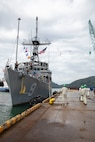 Avenger-class mine countermeasures ship USS Pioneer (MCM 9) moors port side in Uki city port.