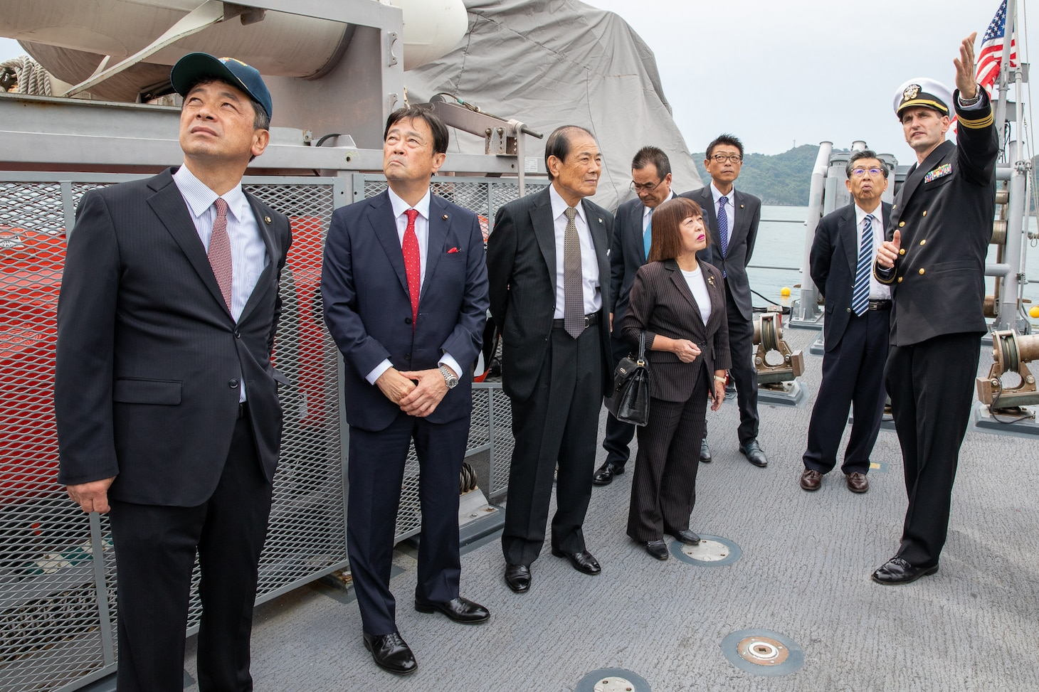 Lt. Cmdr. Bobby Wayland, gives a ship tour to the mayor of Uki city, Kenshi Morita and his staff.