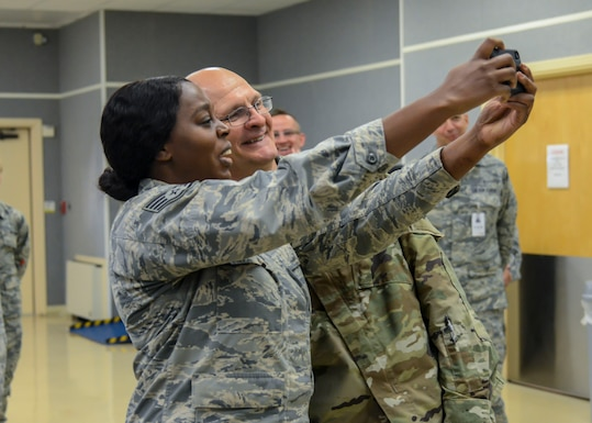 "Staff Sgt. Ruth Elliot, 412th Medical Group, takes a ""selfie"" with Gen. Arnold Bunch, Commander, Air Force Materiel Command, at Edwards Air Force Base, California, Oct. 18. Elliot was a presented a commander's coin by the AFMC commander. (U.S. Air Force photo by Giancarlo Casem)"