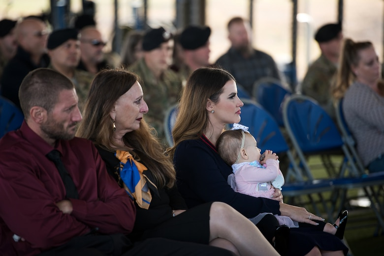 The family of U.S. Air Force Capt. Daniel Hill, incoming commander, listens as Capt. Hill speak to the audience during the activation and assumption of command ceremony of Detachment 2, Combat Training Squadron, Sept. 17, 2019, at Joint Base San Antonio-Medina Annex, Texas.