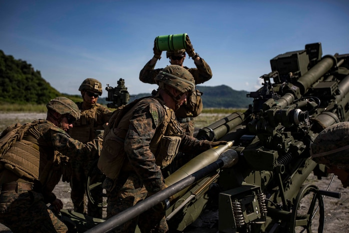 """U.S. Marines with Alpha Battery, Battalion Landing Team, 3rd Battalion, 5th Marine Regiment, 11th Marine Expeditionary Unit, prepare to fire an M777 Howitzer during exercise KAMANDAG 3 at Colonel Ernesto P. Ravina Air Base, Philippines, Oct. 13, 2019. KAMANDAG helps participating forces maintain a high level of readiness and responsiveness, and enhances combined military-to-military relations, interoperability, and multinational coordination. KAMANDAG is an acronym for the Filipino phrase """"Kaagapay Ng Mga Manirigma Ng Dagat,"""" which translates to """"Cooperation of the Warriors of the Sea,"""" highlighting the partnership between the U.S. and Philippine militaries."""