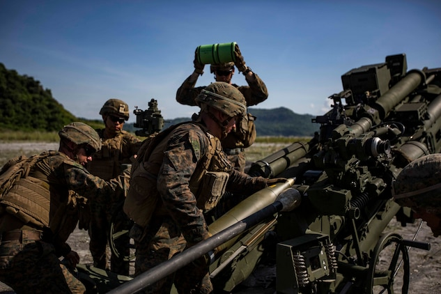 "U.S. Marines with Alpha Battery, Battalion Landing Team, 3rd Battalion, 5th Marine Regiment, 11th Marine Expeditionary Unit, prepare to fire an M777 Howitzer during exercise KAMANDAG 3 at Colonel Ernesto P. Ravina Air Base, Philippines, Oct. 13, 2019. KAMANDAG helps participating forces maintain a high level of readiness and responsiveness, and enhances combined military-to-military relations, interoperability, and multinational coordination. KAMANDAG is an acronym for the Filipino phrase ""Kaagapay Ng Mga Manirigma Ng Dagat,"" which translates to ""Cooperation of the Warriors of the Sea,"" highlighting the partnership between the U.S. and Philippine militaries."