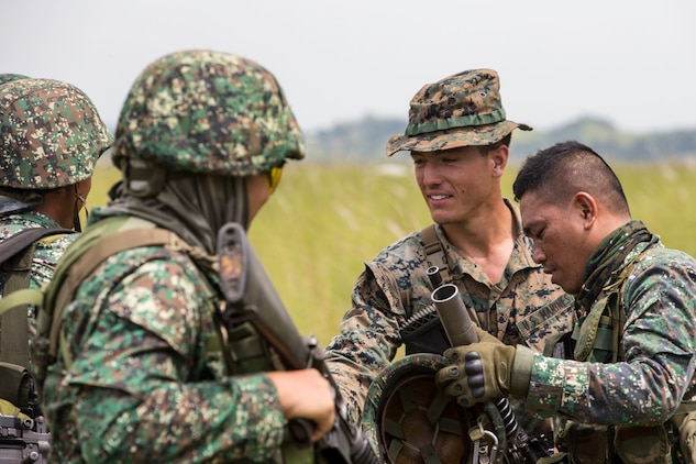 "Philippine Marines exchange infantry tactics with U.S. Marine Cpl. Christian Salvaggio prior to a live fire range conducted during KAMANDAG 3 at Colonel Ernesto P. Ravina Air Base, Philippines, Oct. 14, 2019. The United States is proud to participate in this Philippine-led, bilateral exercise in order to develop capabilities across a wide range of military operations. Salvaggio, a native of Johnston, Pa., is a squad leader with Easy Company, 2nd Battalion, 2nd Marine Regiment. KAMANDAG is an acronym for the Filipino phrase ""Kaagapay Ng Mga Manirigma Ng Dagat,"" which translates to ""Cooperation of the Warriors of the Sea,"" highlighting the partnership between the U.S. and Philippine militaries."