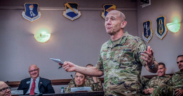 General Mike Holmes, commander of Air Combat Command, speaks to judges during ACC's 2020 Spark Tank competition at the Creech Conference Center on Joint Base Langley-Eustis, Virginia, Oct. 16, 2019. Six teams of Airmen from bases across ACC presented their ideas. The winning teams will move on to the finals in Washington D.C. to compete at the Air Force level against finalists from other commands. (U.S. Air Force photo by Tech. Sgt. Nick Wilson)