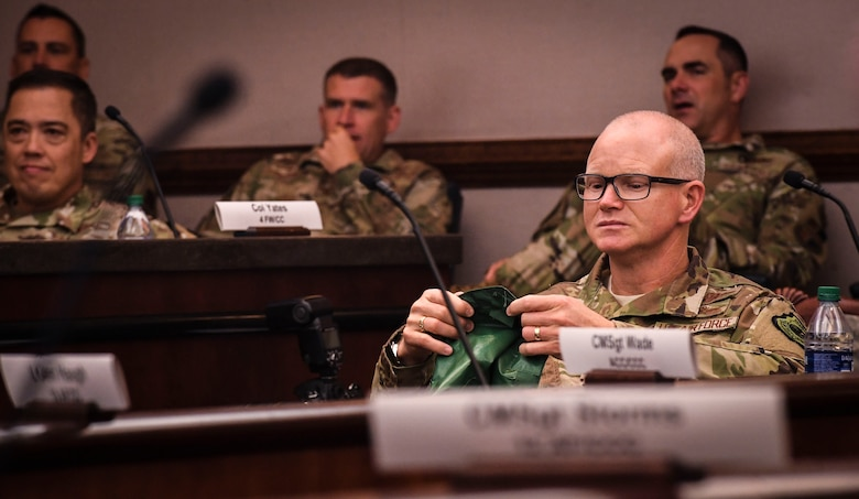 Air Combat Command Deputy Commander Lt. Gen. Christopher P. Weggeman, holds a portable magnetic aircraft cover, during ACC's 2020 Spark Tank competition at the Creech Conference Center on Joint Base Langley-Eustis, Virginia, Oct. 16, 2019. The competition, which is part of an Air Force-wide innovation initiative, encourages Airmen of all ranks and careers generate innovative ideas that save time, money and maintain readiness. (U.S. Air Force photo by Tech. Sgt. Nick Wilson)