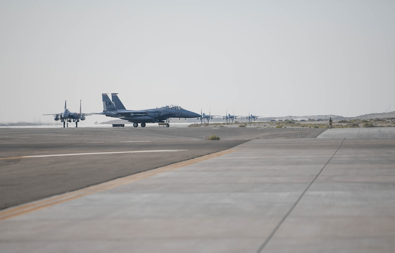 U.S. Air Force F-15E Strike Eagles from the 494th Fighter Squadron taxi to park at Al Dhafra Air Base, United Arab Emirates, Oct. 18, 2019.