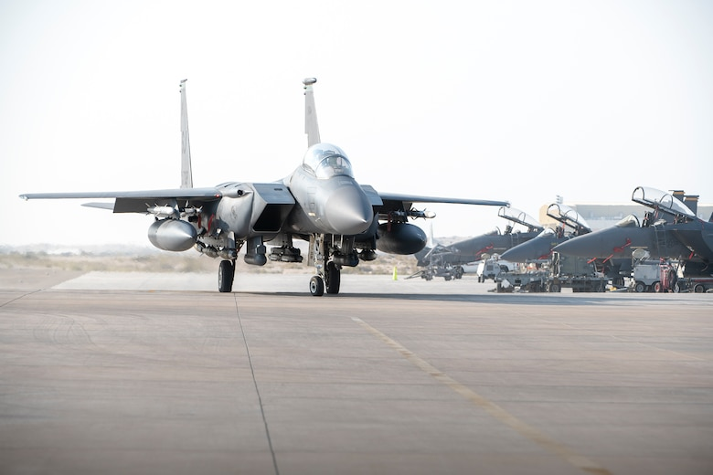 A U.S. Air Force F-15E Strike Eagle from the 494th Fighter Squadron taxi to park at Al Dhafra Air Base, United Arab Emirates, Oct. 18, 2019.