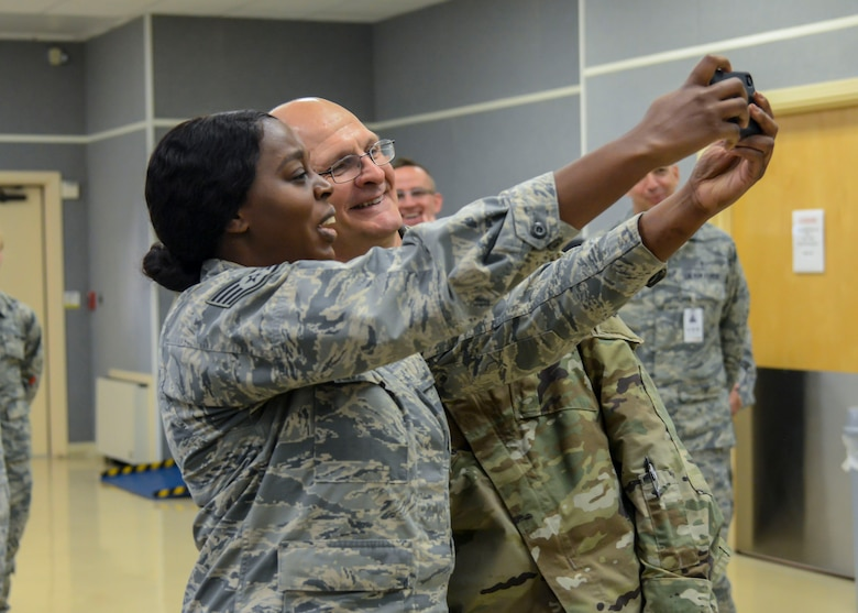"""Staff Sgt. Ruth Elliot, 412th Medical Group, takes a """"selfie"""" with Gen. Arnold Bunch, Commander, Air Force Materiel Command, at Edwards Air Force Base, California, Oct. 18. Elliot was a presented a commander's coin by the AFMC commander. (U.S. Air Force photo by Giancarlo Casem)"""