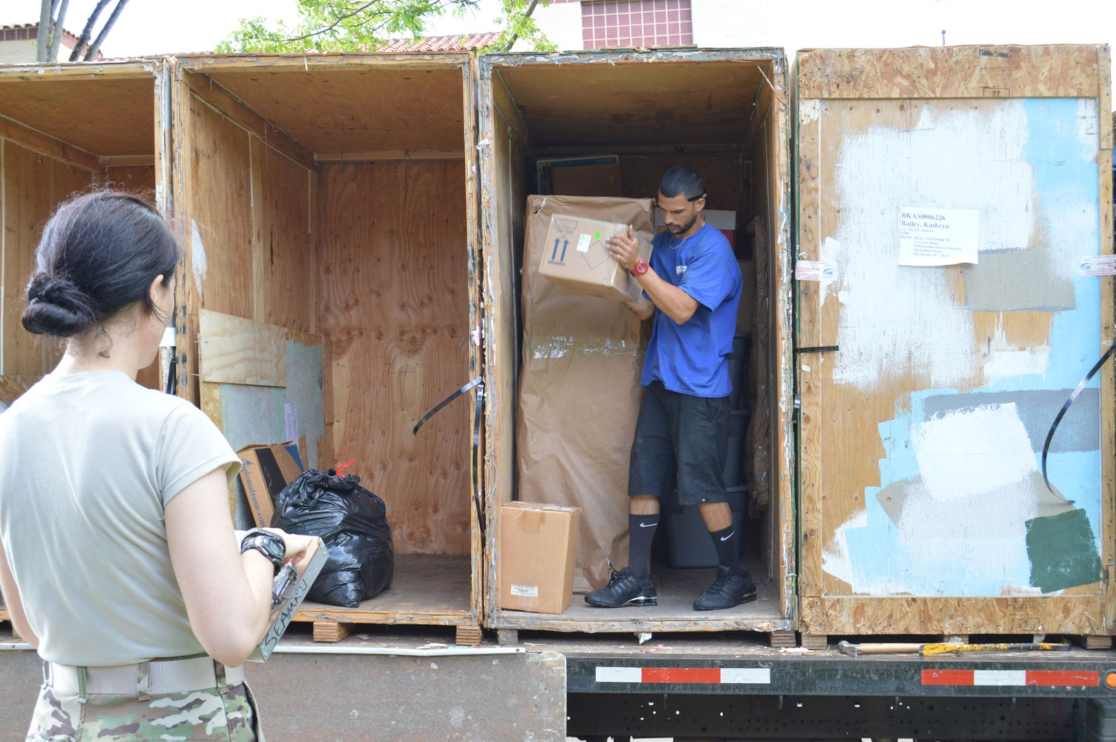 1st Lt. Kathryn Bailey, a Blackhawk pilot with the 2nd Battalion, 25th Aviation Regiment, 25th Combat Aviation Brigade, 25th Infantry Division, supervises the delivery and unpacking of her household items May 11 on Wheeler Army Airfield, Hawaii.