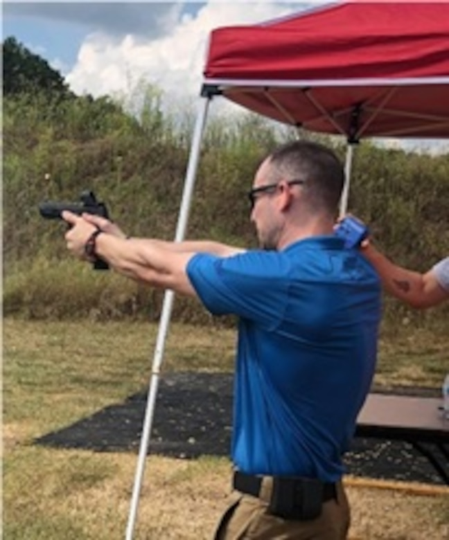 Maj. Jesse Campbell, Current Operations Integrating Cell (412th Theater Engineer Command), engages targets at the Mississippi Steel Challenge Championship in a Carry Optics Division event. This event also served as a charity for The Boy Scouts of America. Maj. Campbell won his skill Classification in the Carry Optics Division.