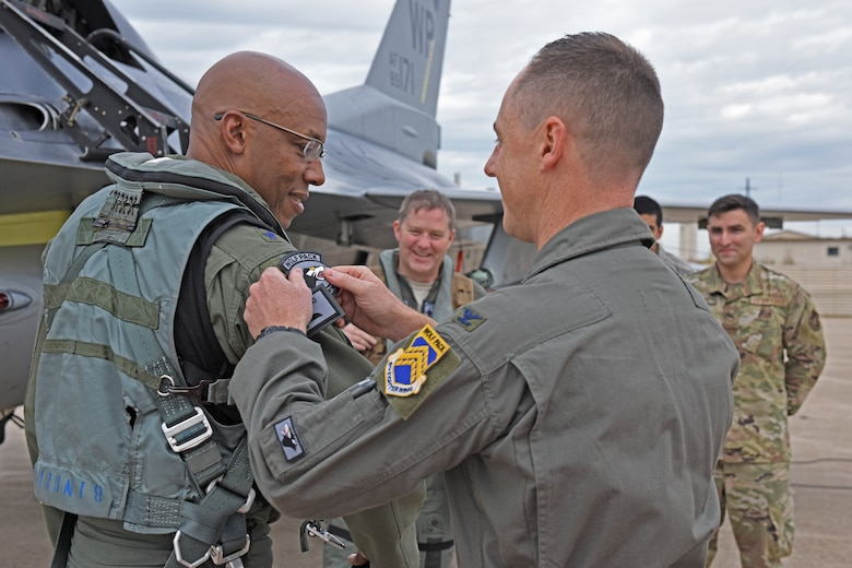 "U.S. Air Force Gen. CQ Brown, Jr. Pacific Air Forces commander, receives a Wolf Pack patch from Col. Tad Clark, 8th Fighter Wing commander, during a visit at Kunsan Air Base, Republic of Korea, Oct. 18, 2019. Brown was stationed at Kunsan from April 1987 to October 1988 as a first lieutenant and then again from May 2007 to May 2008, where he led the Wolf Pack as ""Wolf 46."" (U.S. Air Force photo by Staff Sgt. Mackenzie Mendez)"
