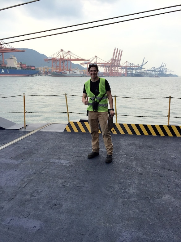 2nd Lt. Chad Cleary, then a U.S. Merchant Marine Academy cadet, working cargo operations in Ulsan, South Korea. Part of the job was to make sure outgoing Army/Air Force cargo was correct in getting off at that port and ensuring incoming cargo was secured correctly and in the right location. Photo taken on M/V Liberty Promise.