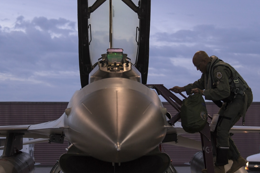 Gen. CQ Brown, Jr., Pacific Air Forces commander, climbs into a 36th Fighter Squadron F-16 Fighting Falcon prior to take off at Osan Air Base, Republic of Korea, Oct. 18, 2019. After gaining an in-depth exposure to the installation's unique mission, Brown visited Kunsan AB to explain PACAF's priorities and how vital the Korean Peninsula is in contributing to the Indo-Pacific region's security and stability (U.S. Air Force photo by Staff Sgt. Greg Nash)