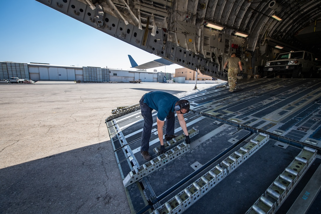 Staff Sgt. Tony Bellow, NCO-in-charge of Cargo Operations, Jordan Port, 387th Air Expeditionary Squadron, removes rollers from the cargo ramp of a U.S. Air Force C-17 Globemaster III before unloading vehicles in Jordan, Oct. 14, 2019.