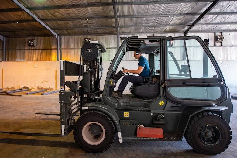 Staff Sgt. Tony Bellow, NCO-in-charge of Cargo Operations, Jordan Port, 387th Air Expeditionary Squadron, operates a fork-lift inside a warehouse while positioning cargo for future movements in Jordan, Oct. 14, 2019.