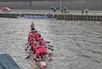 a dragon boat team paddles in the water