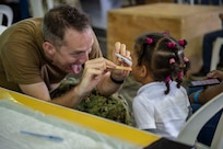 A U.S. Navy doctor examines a child.