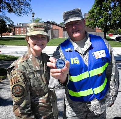 Gen. Maryanne Miller, the commander of Air Mobility Command at Scott Air Force Base, Ill., made a special coin presentation to Senior Master Sgt. Todd Wadkins at the 932nd Airlift Wing for his consistent hard work and assistance during a recent full spectrum readiness inspection held September 19, 2019.  The men and women of AMC, consisting of active duty, Air National Guard, Air Force Reserve and civilians, provide airlift, aerial refueling, special air mission, aeromedical evacuation and mobility support. Wadkins worked recently with maintenance and formerly served as the 932nd Airlift Wing's Ground Safety Manager, and is retiring after 30 years of military service to America.