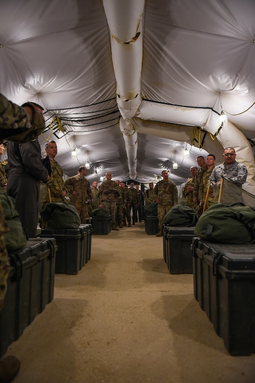 Leadership members from the 62nd Airlift Wing, Joint Base Lewis-McChord, Wash., look around a tent at the 319th Training Squadron, basic expeditionary Airman skills training (BEAST) headquarters, Lackland Air Force Base, Texas, Oct. 17, 2019. U.S. Air Force basic trainees spend one out of the eight weeks of basic military training (BMT) at BEAST, where they fulfill about 80 percent of their BMT graduation requirements.