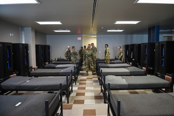 Leadership members from the 62nd Airlift Wing, Joint Base Lewis-McChord (JBLM), Wash., look around a basic military training dormitory in the 321st Training Squadron (321 TRS) at Lackland Air Force Base, Texas, Oct. 17, 2019. U.S. Air Force basic military trainees are required to meet specific requirements in the presentation of their wall lockers and dormitory.
