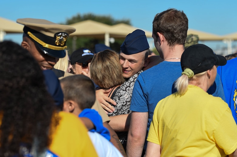 A U.S. Air Force basic military training graduate embraces one of their visitors after marching in their graduation parade on Lackland Air Force Base, Texas, Oct. 18, 2019. After the graduation parade where new graduates march across the enlisted heroes walk, they are released to their families and visitors for the day.