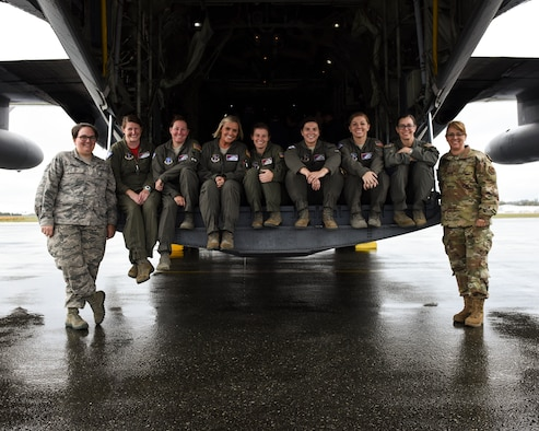 An all-female aircrew assigned to the 189th Operations Group, 189th Airlift Wing, Arkansas Air National Guard, take a group picture after just landing in Abbottsford, British Columbia, Canada to support the annual Sky's No Limit – Girls Fly Too aerial symposium. This is the first all-female C-130 H crew in the history of the annual event.
