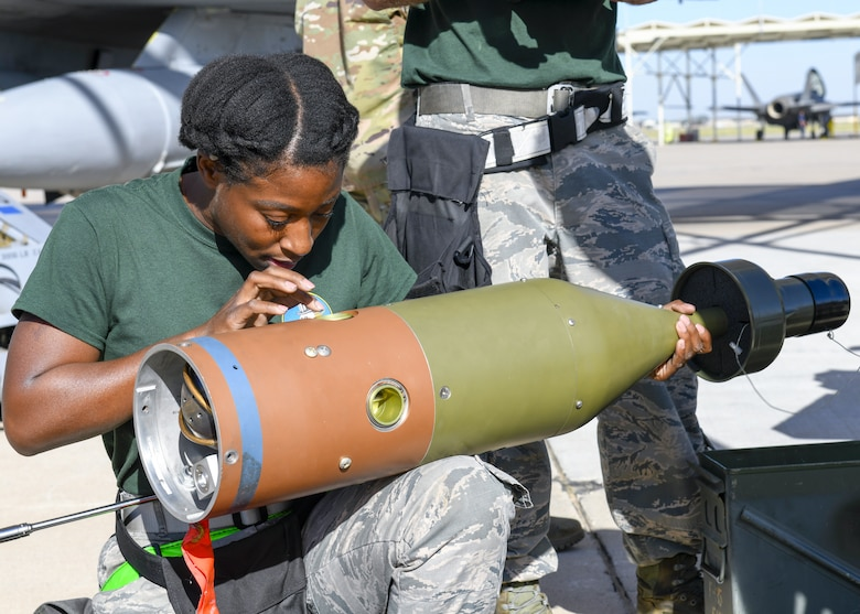 Senior Airman Felicia Richmond, 310th Aircraft Maintenance Unit weapons load crew member, inspects an inert bomb during the 3rd Quarter Load Crew Competition Oct. 17, 2019, at Luke Air Force Base, Ariz.