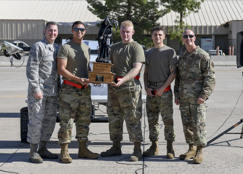 Members from the 63rd Aircraft Maintenance Unit accept a trophy after winning the 3rd Quarter Load Crew Competition Oct. 17, 2019, at Luke Air Force Base, Ariz.