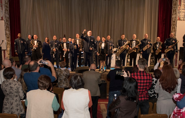 "Musicians from the U.S. Air Forces in Europe Ambassadors Jazz Band and the Ukrainian National Presidential Orchestra join the audience in shouting, ""Slava Ukrayini!"" (""Glory to Ukraine!""), a common Ukrainian expression, at the end of a concert at the Philharmonic in Chernivisti, Ukraine, Oct. 12, 2019. The USAFE Band traveled to six cities in central and western Ukraine October 6-20, 2019 to conduct the ""Music of Freedom"" tour, which celebrated the shared spirit of freedom and enduring partnership between U.S. and Ukrainian armed forces. (U.S. Air Force photo by Airman 1st Class Jennifer Zima)"