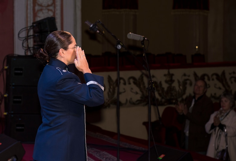 "U.S. Air Force Lt. Col Cristina Moore Urrutia, U.S. Air Forces in Europe Ambassadors Jazz Band commander and conductor, salutes the citizens of Vinnytsia during a concert with the USAFE Band and the Ukrainian National Presidential Orchestra at the Music and Drama Theater in Vinnytsia, Ukraine, October 14, 2019. The USAFE Band traveled to six cities in central and western Ukraine October 6-20, 2019 to conduct the ""Music of Freedom"" tour, which celebrated the shared spirit of freedom and enduring partnership between U.S. and Ukrainian armed forces. (U.S. Air Force photo by Airman 1st Class Jennifer Zima)"